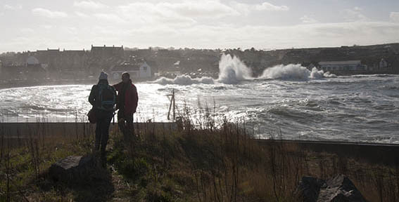 Eyemouth Waves behind Dave and Jo